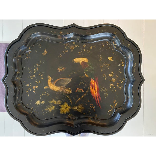 This ebonized faux bamboo base table with a removable Handpainted tray is a perfect statement piece, as the parrot design...