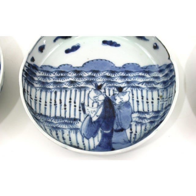 Lovely antique set of Japanese bowls from the Meiji period. Five matching shallow bowls done in blue and white that show...