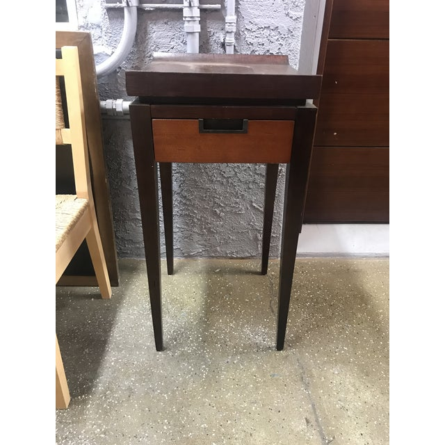 japanese style accent table with one drawer. Nice simple lines with a nice curve top.