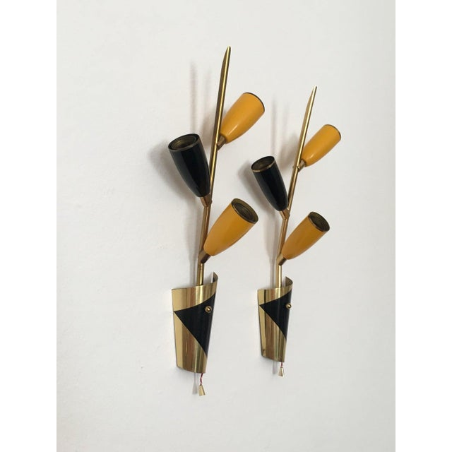 Sconces from the 50s. Wonderful Italian design. Rewired Dimensions per lamp: Height: 37 cm/ 14.57 in. Width: 14 cm/ 5.51...