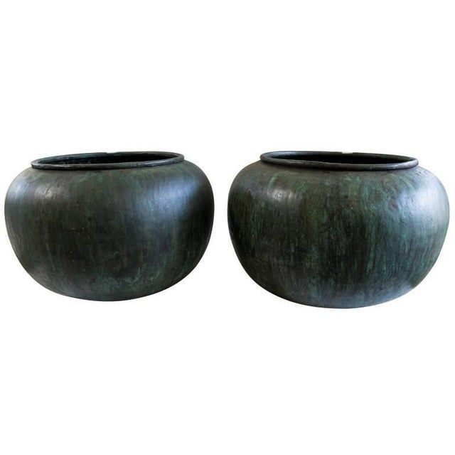 The tomato shape and oxidized copper blue patina give these vessels an alluring quality.