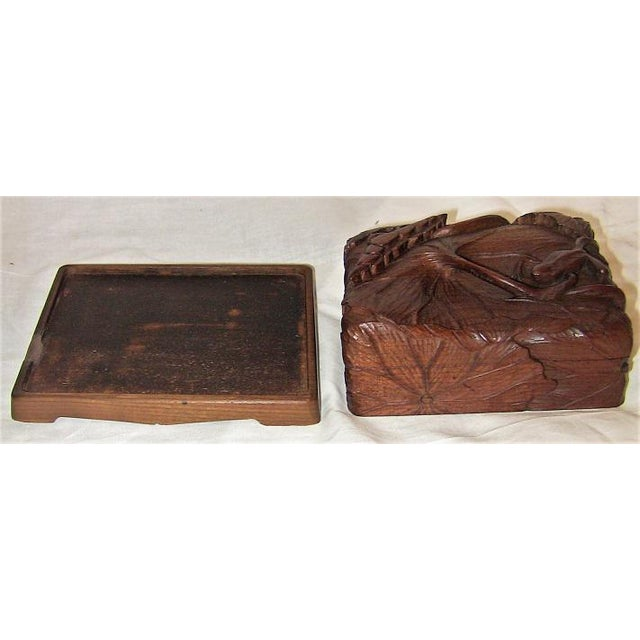 PRESENTING a GLORIOUS piece of Japanese carving and treen from circa 1890. This is a lidded wooden box, on a stand, made...