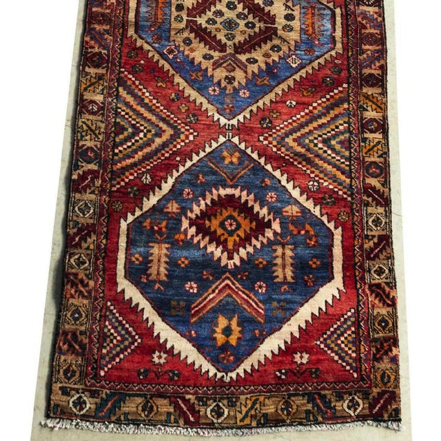 """Rich colored hand-tied Persian Kazak floor runner. This runner has a think pile. Made of wool. Dimensions 9'8"""" X 3'5""""..."""