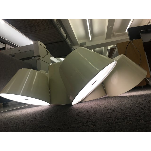 This is a floor model piece - it has never been used, aside from being a showroom piece. This designer light retails at...