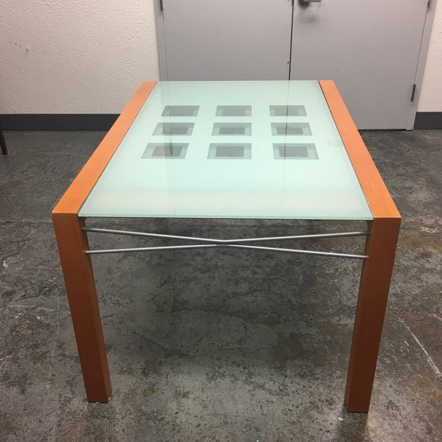 Design Plus Consignment Gallery presents the Ligne Roset Dining Table. constructed of a solid beech frame finished in...