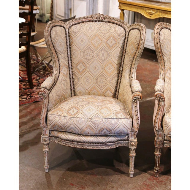 """Dress a living room with this elegant pair of antique armchairs. Crafted in France circa 1870, each """"Fauteuil a Oreilles""""..."""