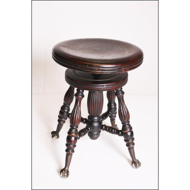 Antique PIANO STOOL. Solid hardwood (probably oak) with a dark finish. Piece has a nice, quality Victorian feel. Beautiful...