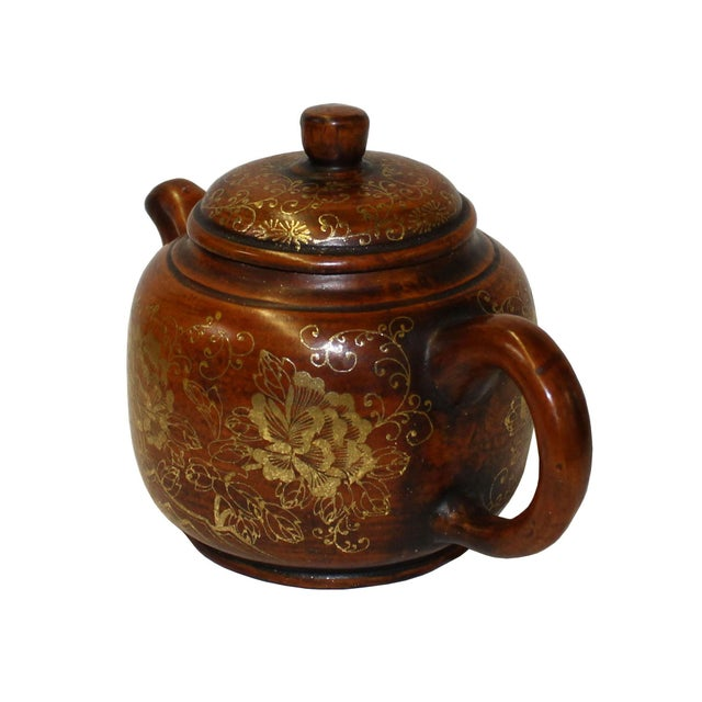 This is an art work display of oriental Chinese teapot which is made of Zisha clay and hand painted with golden color...