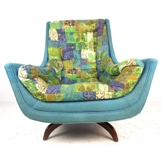 "Stunning lounge chair features elaborate colorful upholstery, 15"" seat height, and functions as a swivel or rocking chair...."