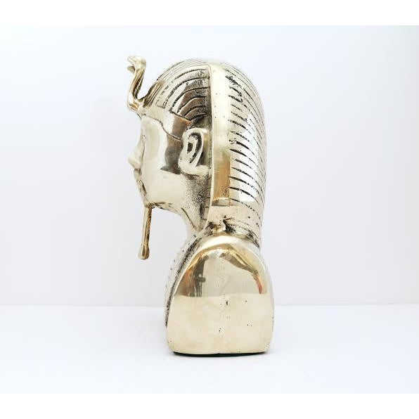 This listing is for a vintage brass King Tut statue. It has beautiful design & detail throughout. Weighs about 5 lbs. 12 oz.