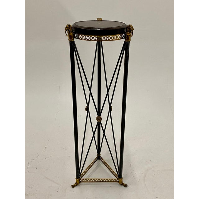 A great looking Empire style pedestal having ebonized steel criss cross base with brass medallions and lions as well as a...