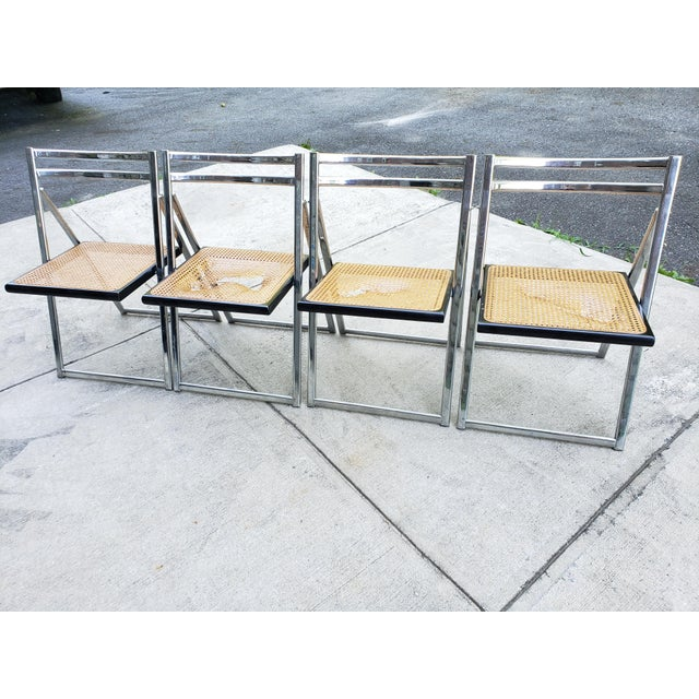 Very stylish Mid Century Modern Folding chairs with cane seats and chrome frames. Sadly 3 of the 4 chairs have a broken...