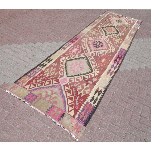 This beautiful, vintage, handwoven kilim is approximately 70 years old. It is handmade of very fine quality, hand-spun...