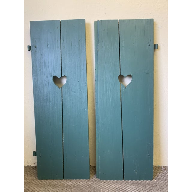 Antique Green Painted Window Shutters with Heart Cutouts, early 1900s. Imported from Germany. Made of wood painted in a...