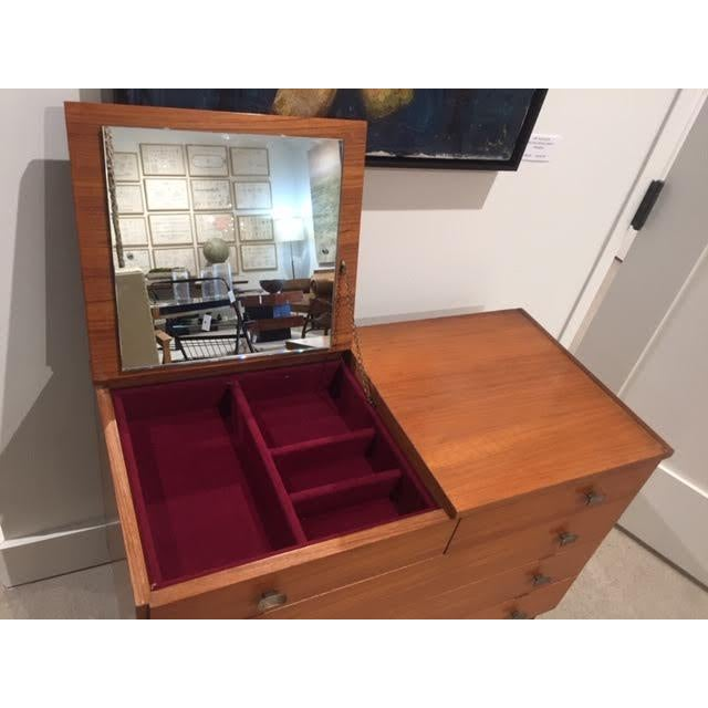 Stunning mid-century Italian chest of drawers with vanity mirror. Features a very unique fold up vanity mirror with...