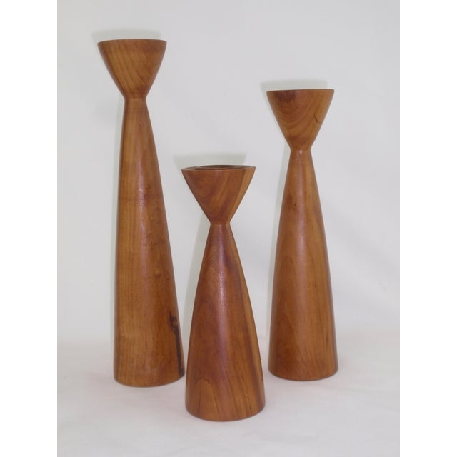 Class up a table with this trio of vintage Danish modern myrtle wood candle holders in varying heights. Streamlined...