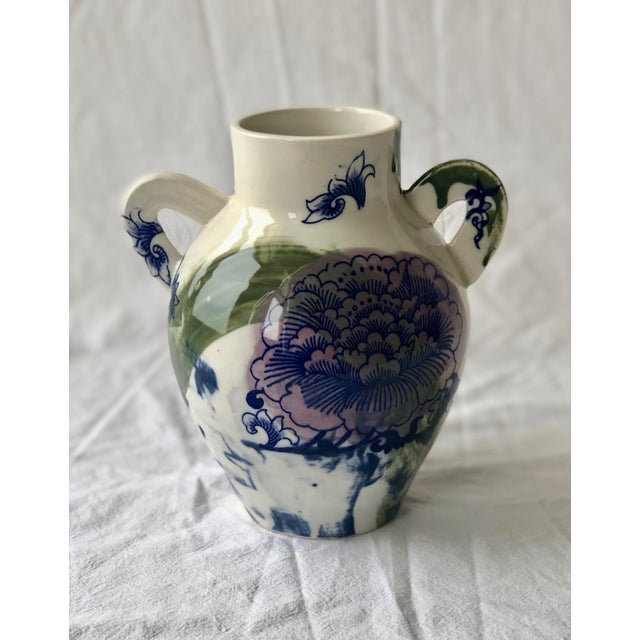 This smaller porcelain vessel is thrown in a classic urn shape with my signature flattened handles added. It is decorated...