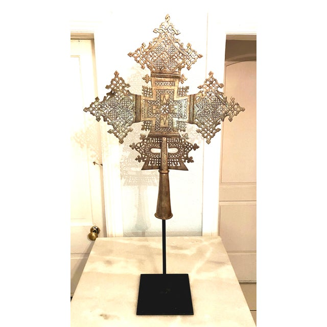Ethiopian Coptic cross handmade and cast in silver and nickel. Intricate metal work. Birds and angels appear on each arm....