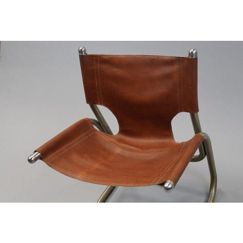 Beautiful mid-century Italian cantilevered aluminum and leather chair, very comfortable and elegantly designed