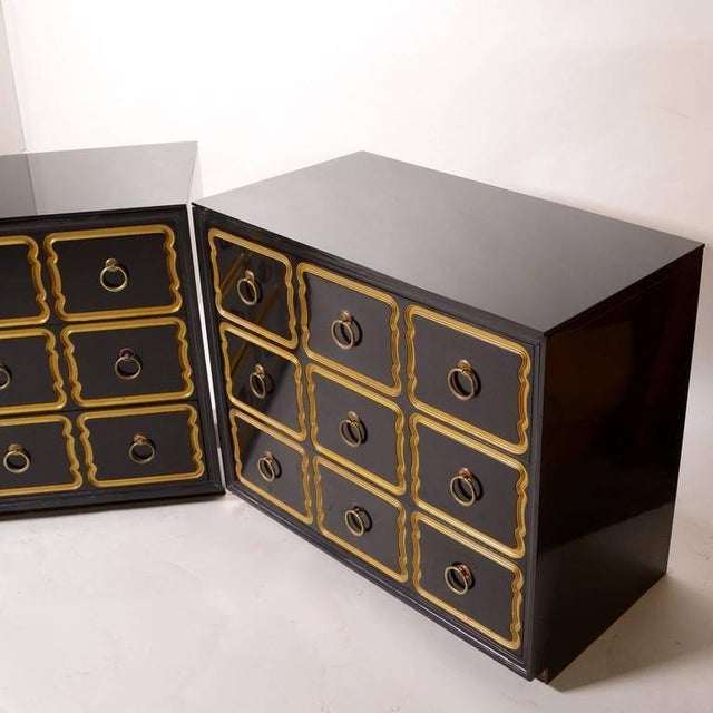 Pair of Dorothy Draper Espana chests / dressers with new black lacquer finish. Large brass ring pulls adorn the centers of...