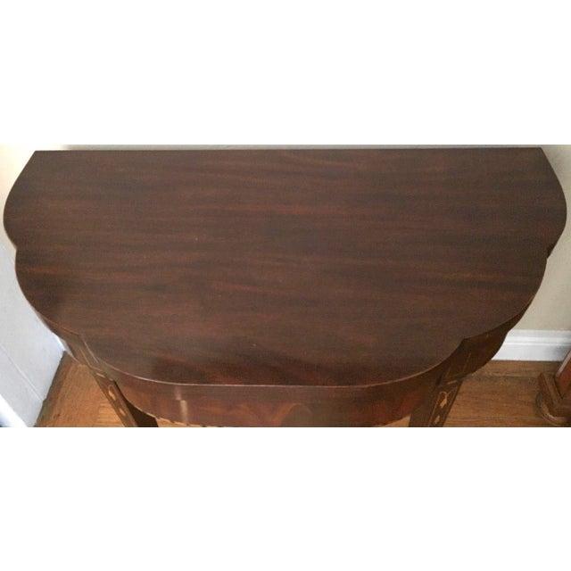 Henkel Harris Myers Mahogany Card Table Model # 5701 Description: This graceful flip-top table has a solid mahogany top...