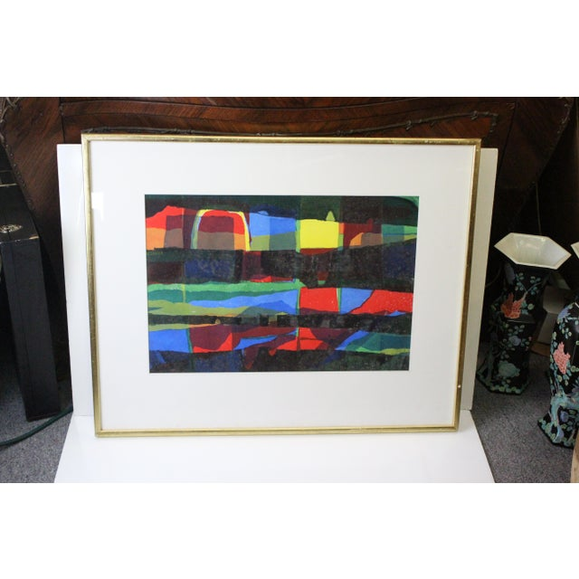 Rainbow print with emphasized shades of red and black, in white mat and worn gilt frame.