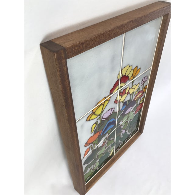 Gorgeous vintage ceramic art comprised of six tiles set into a heavy wood frame. Each piece is decorated with colorfully...