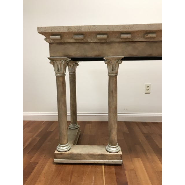 Maitland-Smith classic style with Corinthian columns balusters supporting the fossil stone and marble console table top...