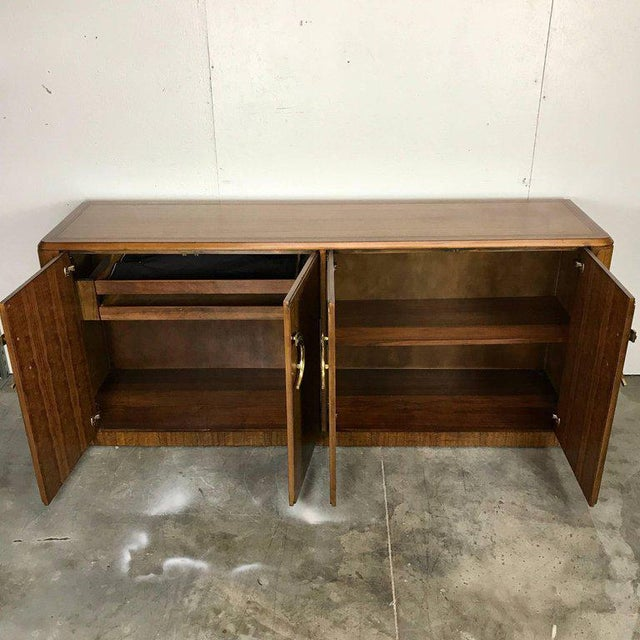Midcentury mahogany and brass credenza by Micheal Taylor for Baker Long subtly carved sculptural cabinet with dual brass...