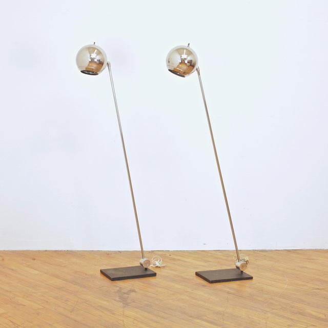 Vintage 1970s Robert Sonneman orb floor lamps for George Kovacs. Chrome heads and flat black base. The head articulates...