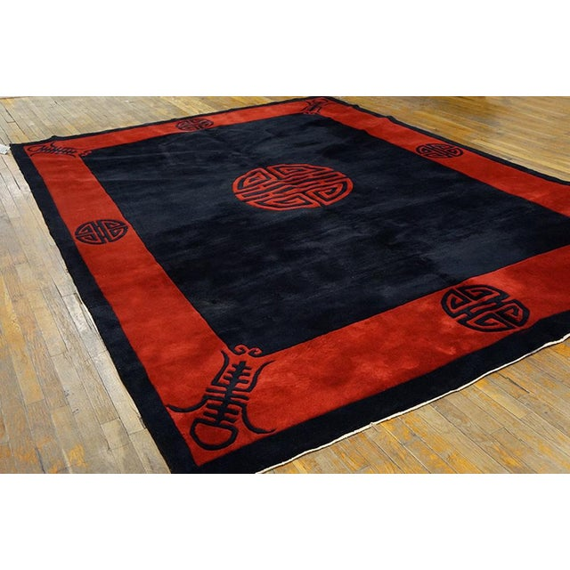 "This is a Chinese art wool rug from China 1920. The size is 8'6""x11'6"". The colors are red and black. There is a border..."