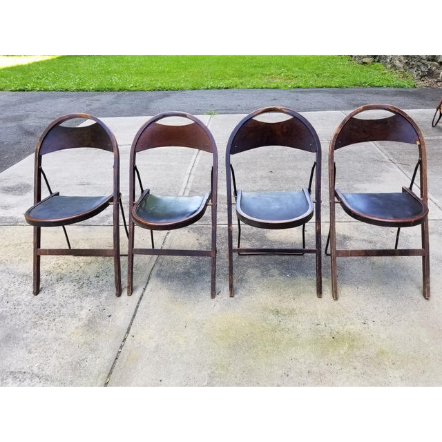 Looking to date to the 1920 or 1930, this is 4 antique Stakmore wooden folding chairs. Stakmore was known for its folding...