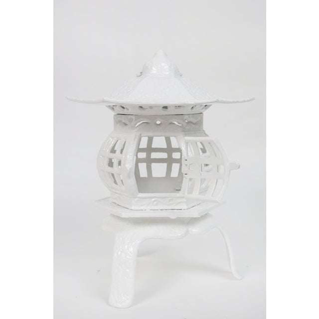 "This is a trio of 1960s cast iron pagodas in white lacquer. Dimensions: 9"" x 9"" x 9"" 11h x 9.5d x 9.5w 13h x 9.75w x 8.75d"