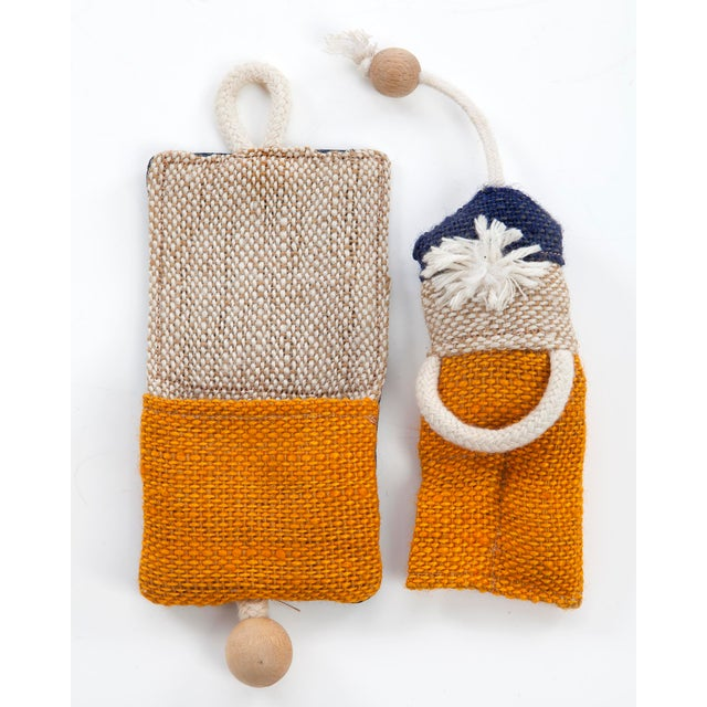 Puppet in pouch. Designed and made by Renate Müller, Germany, 2013.