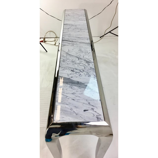 Stylish, modern, contemporary Caracole chrome and Carrara marble magnificent console table, showroom floor sample,...