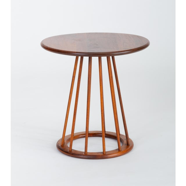 A simply constructed side table from the late 1950s by Arthur Umanoff for New Jersey-based Washington Woodcraft. The table...