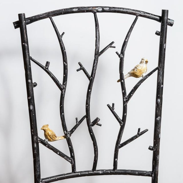 Unusual and rare, charming Faux Bois iron Chairs with Birds Perching In The Branches. Very good vintage condition,...