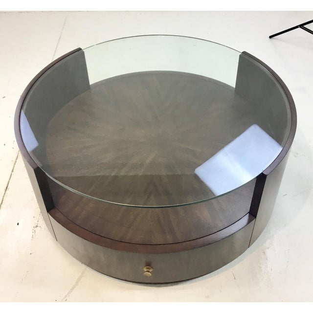 Stylish Drexel Heritage modern walnut finished wood johns cocktail table, glass top, one draw with a brass metal pull,...