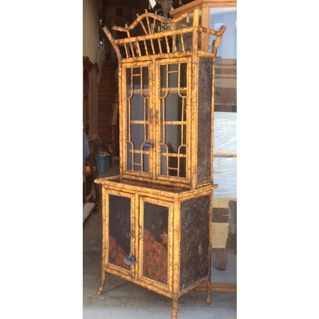 Excellent quality antique English Bamboo Cabinet with glass front upper doors and amazing details inside and out. Normal...