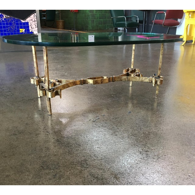 """Spanish ornamental gilt iron coffee table with extremely heavy 3/4"""" oval glass top original to the table immaculate..."""