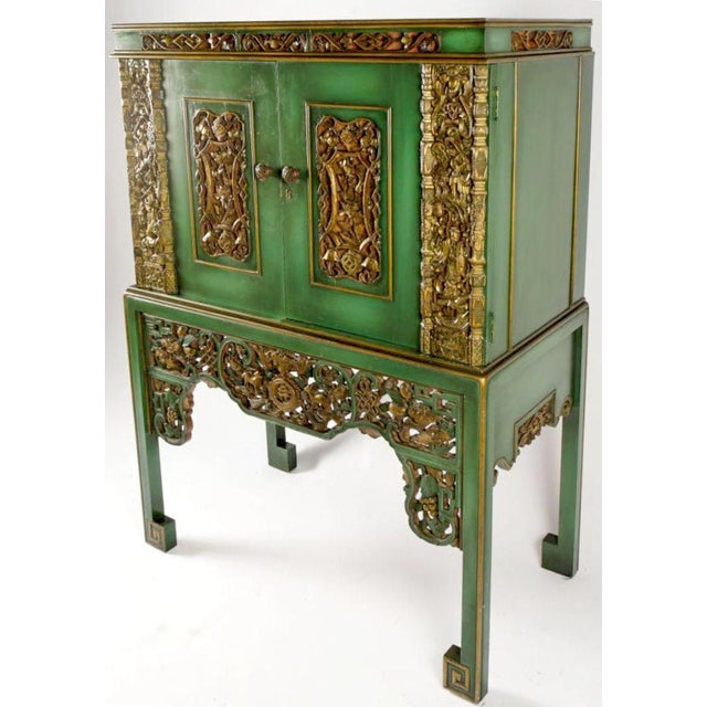 According to the original owner's family, this cabinet was constructed in the 1950s. Nineteenth century carved gilt panels...
