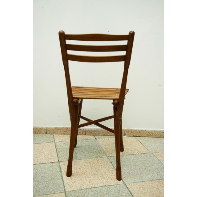 Beechwood garden chair made by Joseph and Jakob Kohn circa 1900. The chair has been professionally restored, stained and...