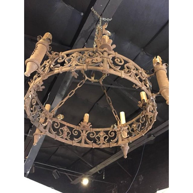 Luxury an antique french forged iron chandelier with fleur de lys an antique french forged iron chandelier with fleur de lys motifs image 4 of 7 aloadofball Gallery