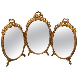 Palatial French Giltwood Triple Oval Shaped Vanity Mirror With Carved Bow Tops For Sale