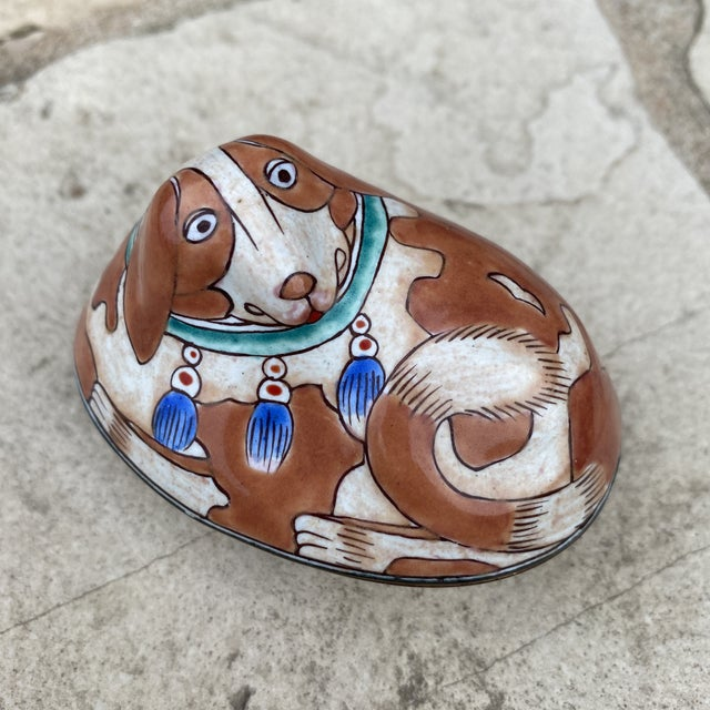 In excellent condition this little box is in the shape of a dog. Very unique piece in enameled metal. Measures roughly...