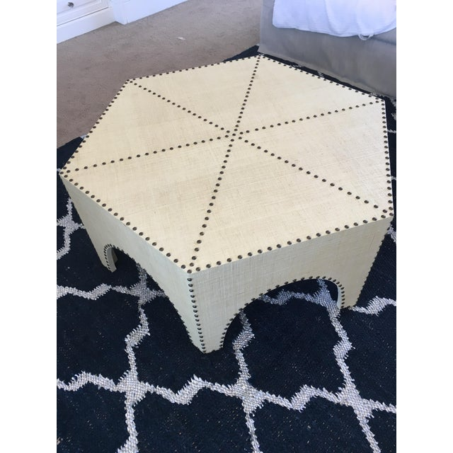 Gorgeous Palecek Casablanca Coffee Table. The table features hand-applied natural raffia with antique brass nailheads....