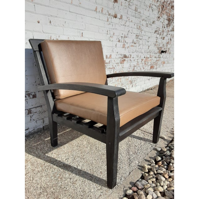 Meet Calvin! This Mission style chair is ready to add some rustic charm to your space. The vinyl cushions and sealed wood...
