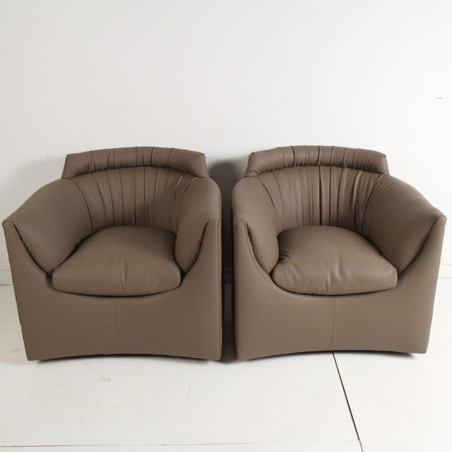 Nice pair of John Saladino lounge chairs in new dark taupe leather. Designed by Saladino as part of the Baker Facade...