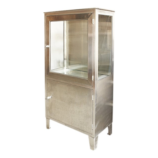 Bright and shiny stainless steel makes this vintage medical cabinet a statement piece. Use it in your modern bathroom for...