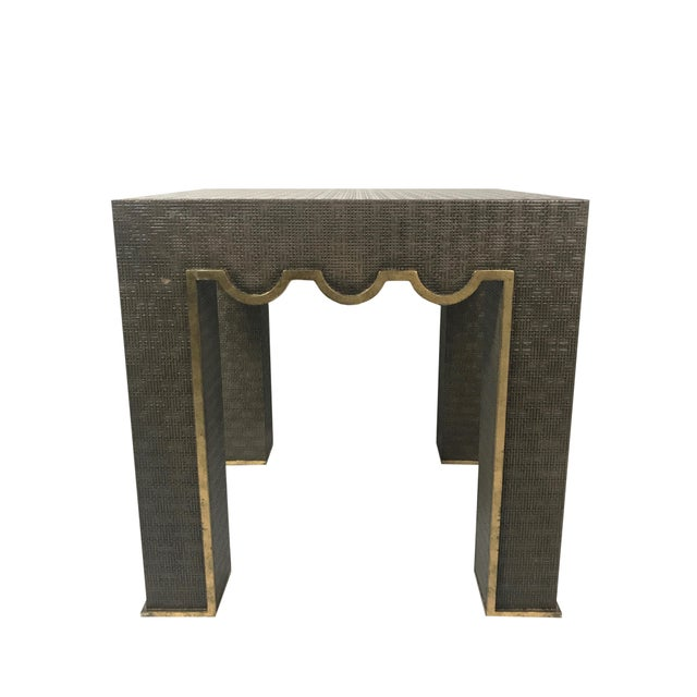 A modern designed end table by Chelsea House. The wooden tables surface is interwoven with raffia in a steel grey finish...